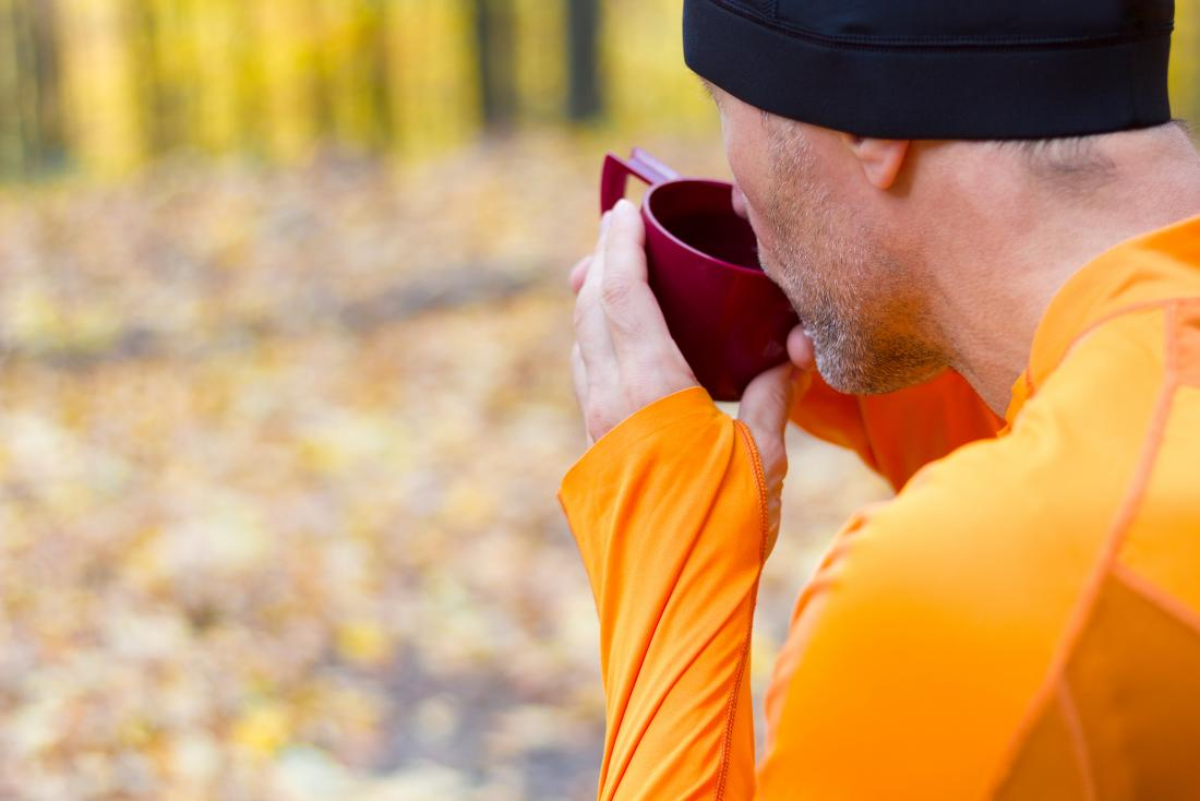 a runner drinking coffee