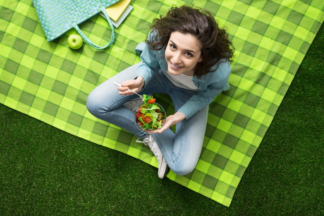 woman sitting on a picnic blanket