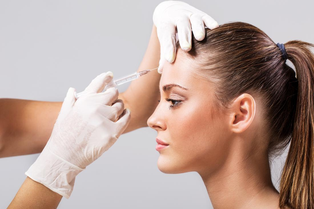 woman having botox injection on forehead
