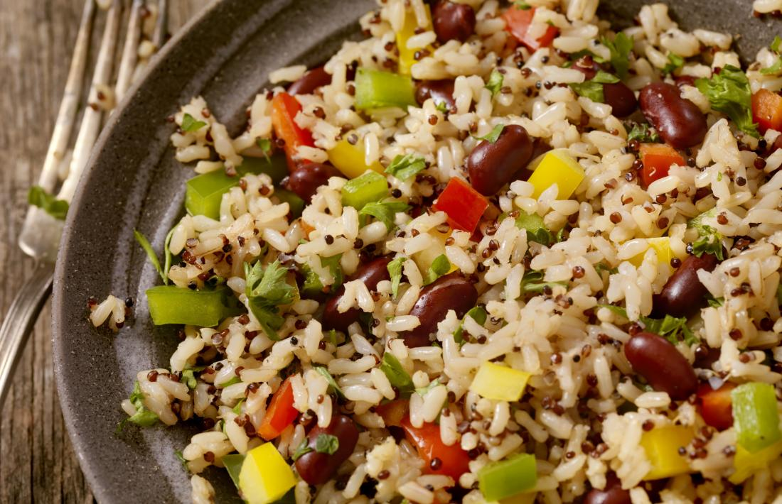 Whole grain brown rice in bowl with pulses, beans, and vegetables.