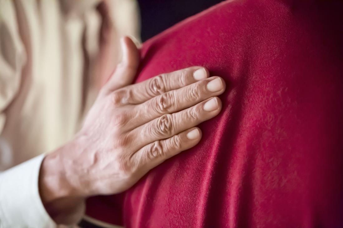 reassuring hand on back