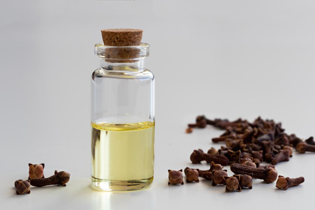 cloves and bottle of clove essential oil