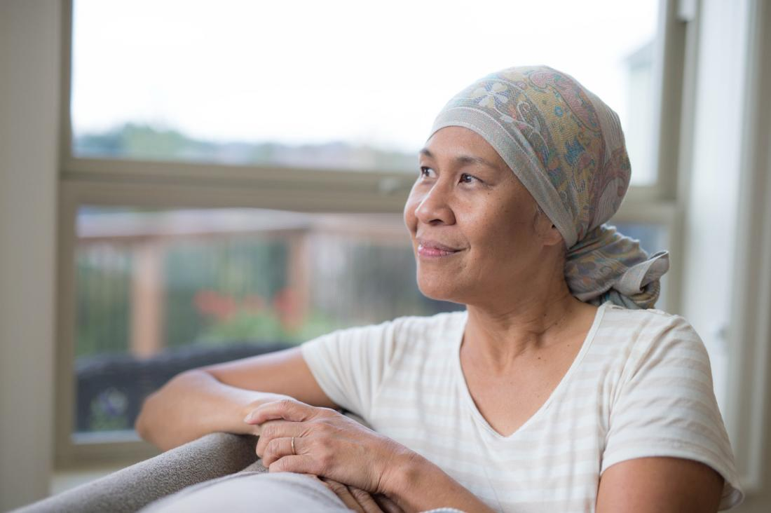 hopeful woman chemo patient looking out the window