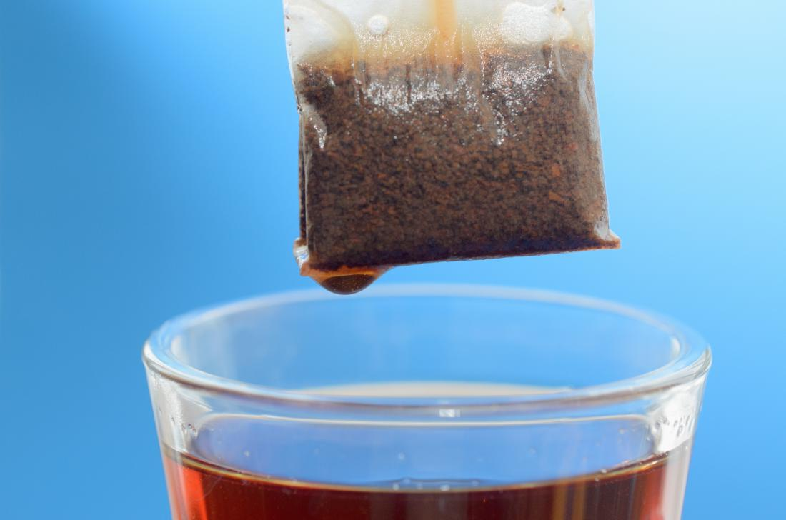 tea bag hovering over cup of tea