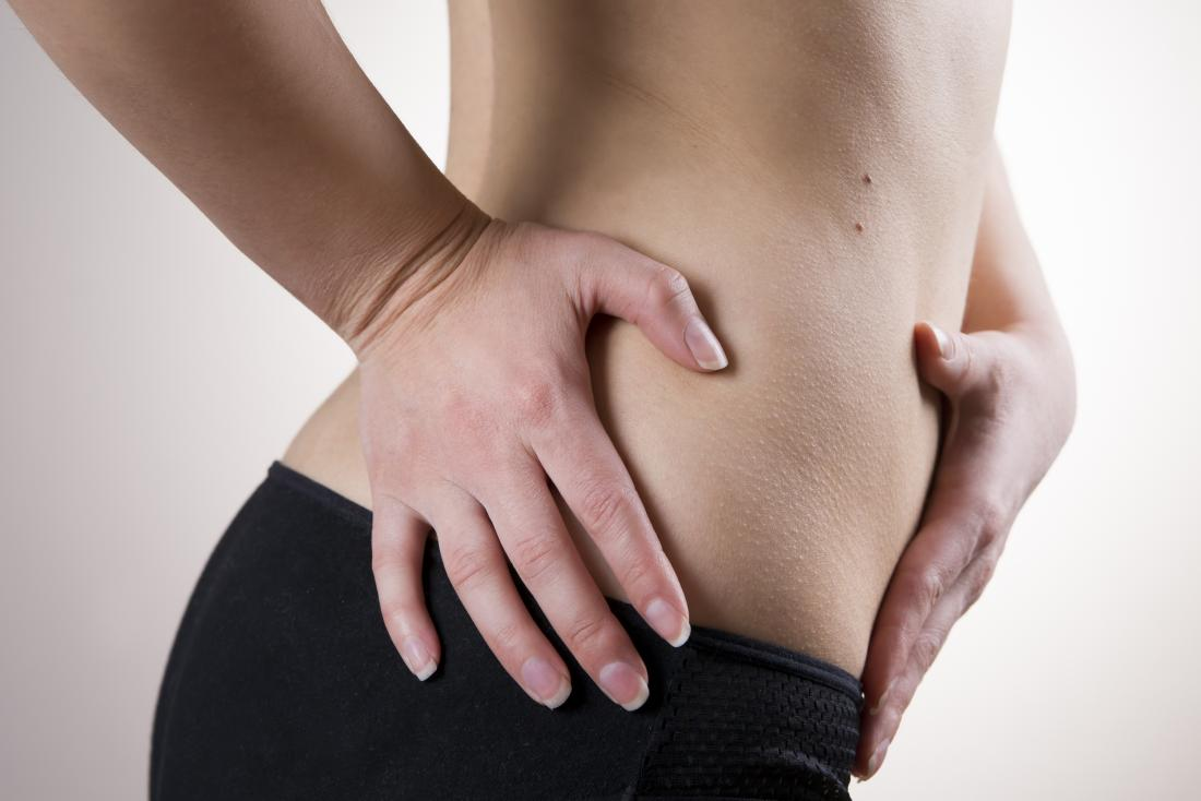 woman with pain on left side of stomach
