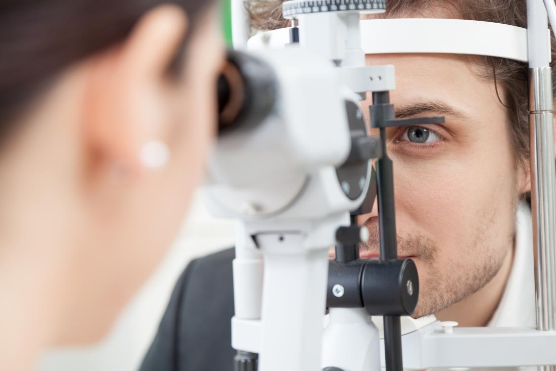 Man having eye exam at opticians.