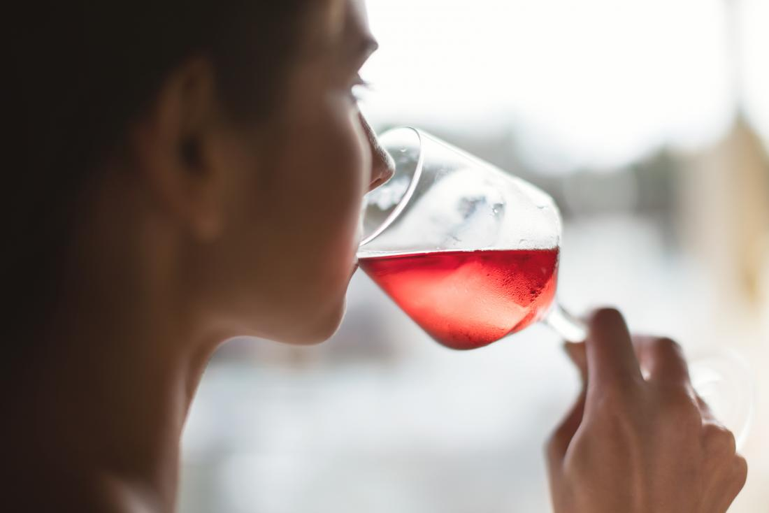 Woman drinking rose wine which may be linked to loose stools