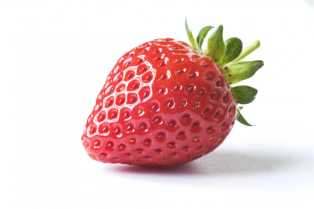 Strawberry on white background to represent strawberry tongue