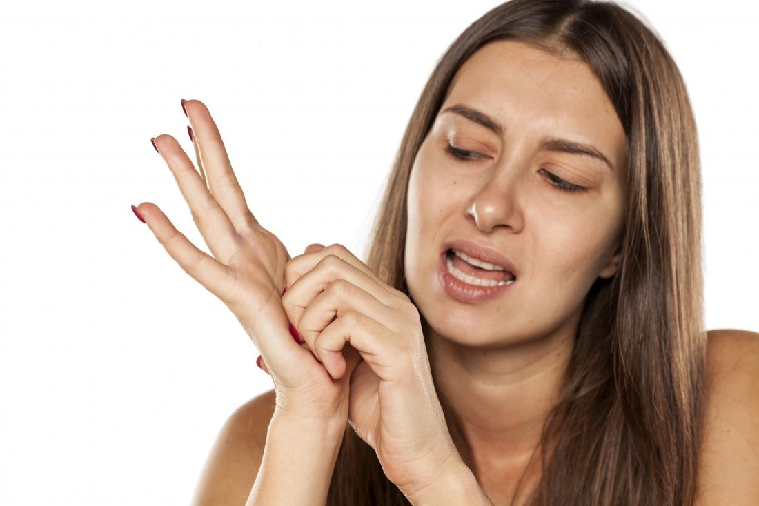 woman scratching the palm of her hand