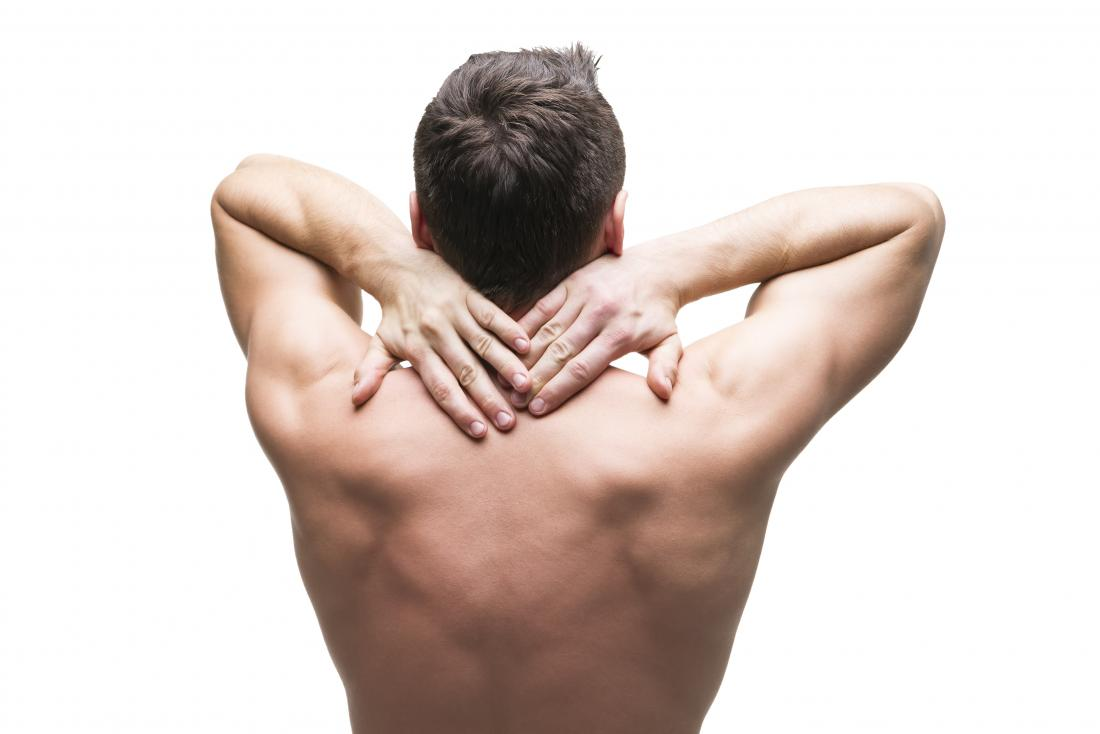 Man holding his upper back in pain and has intercostal muscle strain