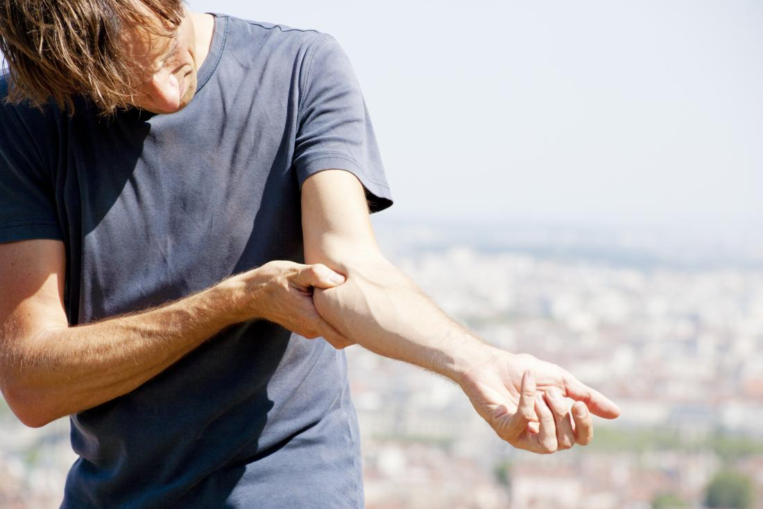 Golfers elbow or medial epicondylitis in man's arm causing pain.