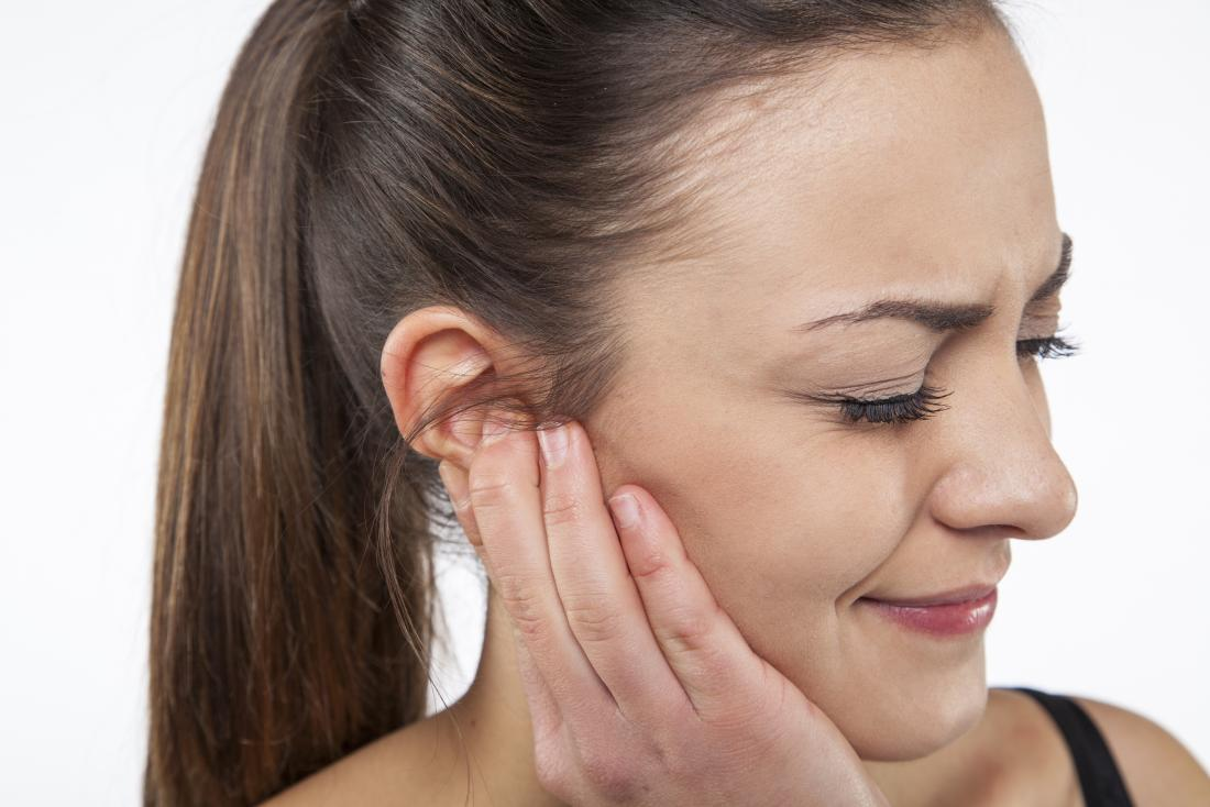 lady with a pimple in ear