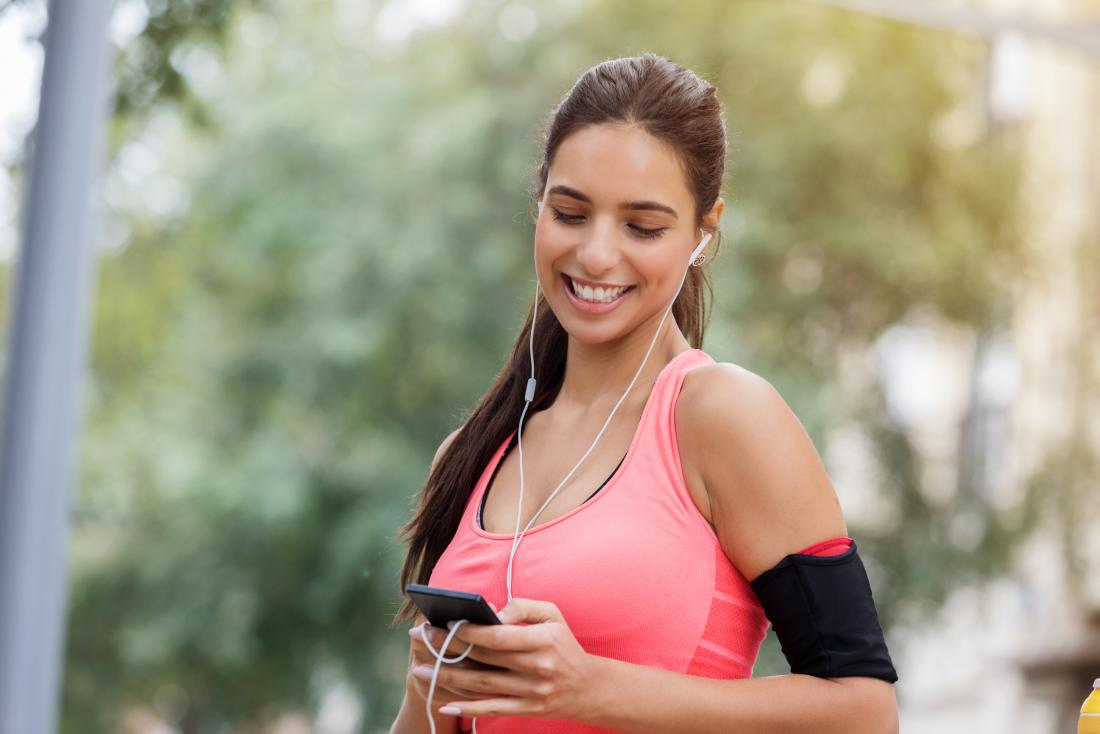 a woman listening to music while exercising
