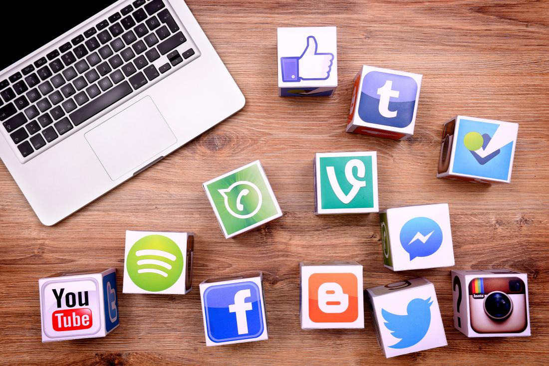 laptop and social media icons