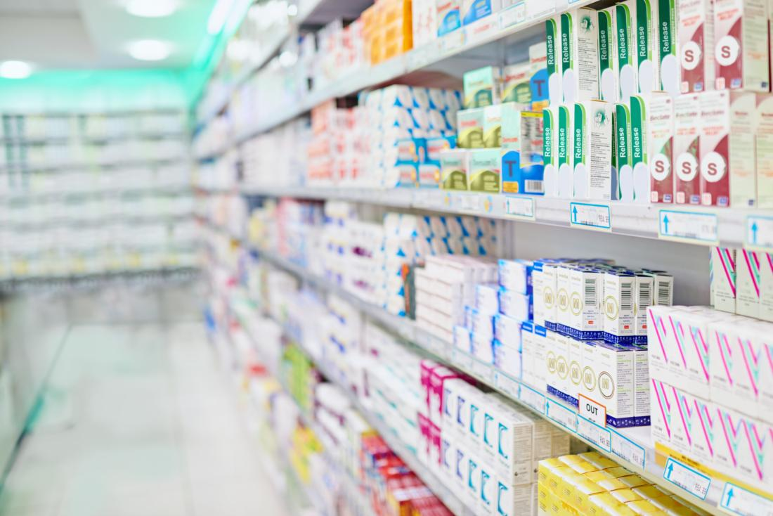 Aisle of medication in pharmacy.