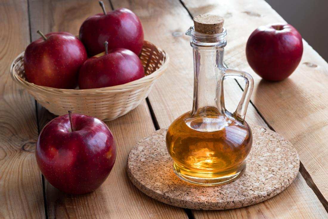 Apple cider vinegar on a table which may be used for warts