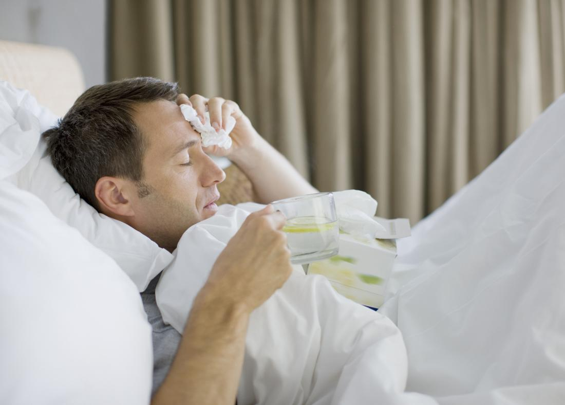 Man with Klebsiella oxytoca infection in bed with fever, chills, cough.
