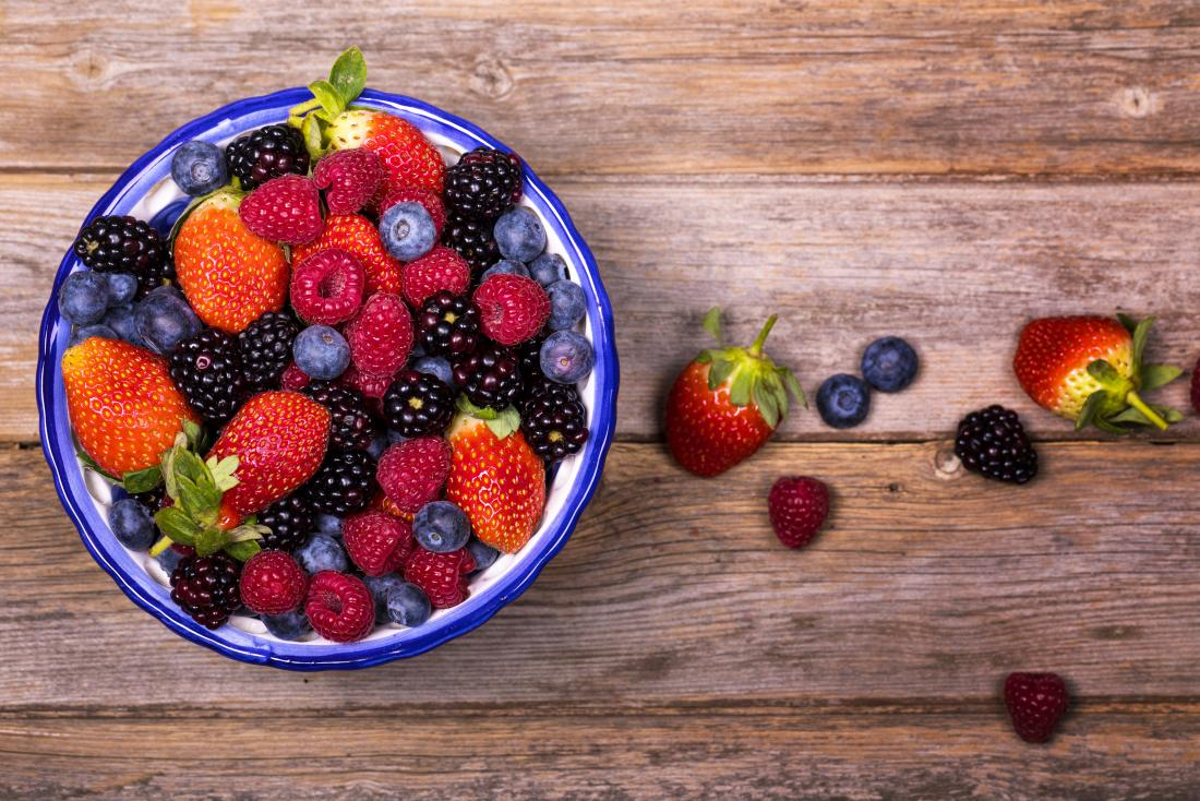 Strawberries, blueberries, raspberries, and blackberries in a bowl as part of the diet for an enlarged prostate.