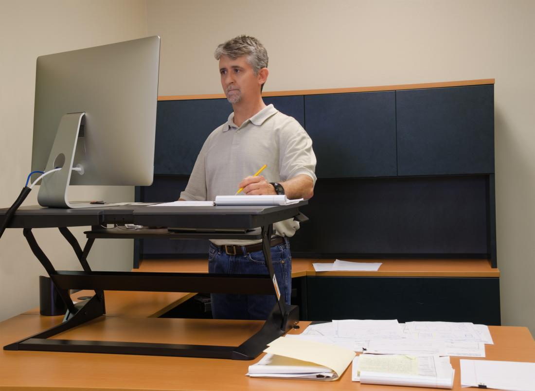 A man using a standing desk