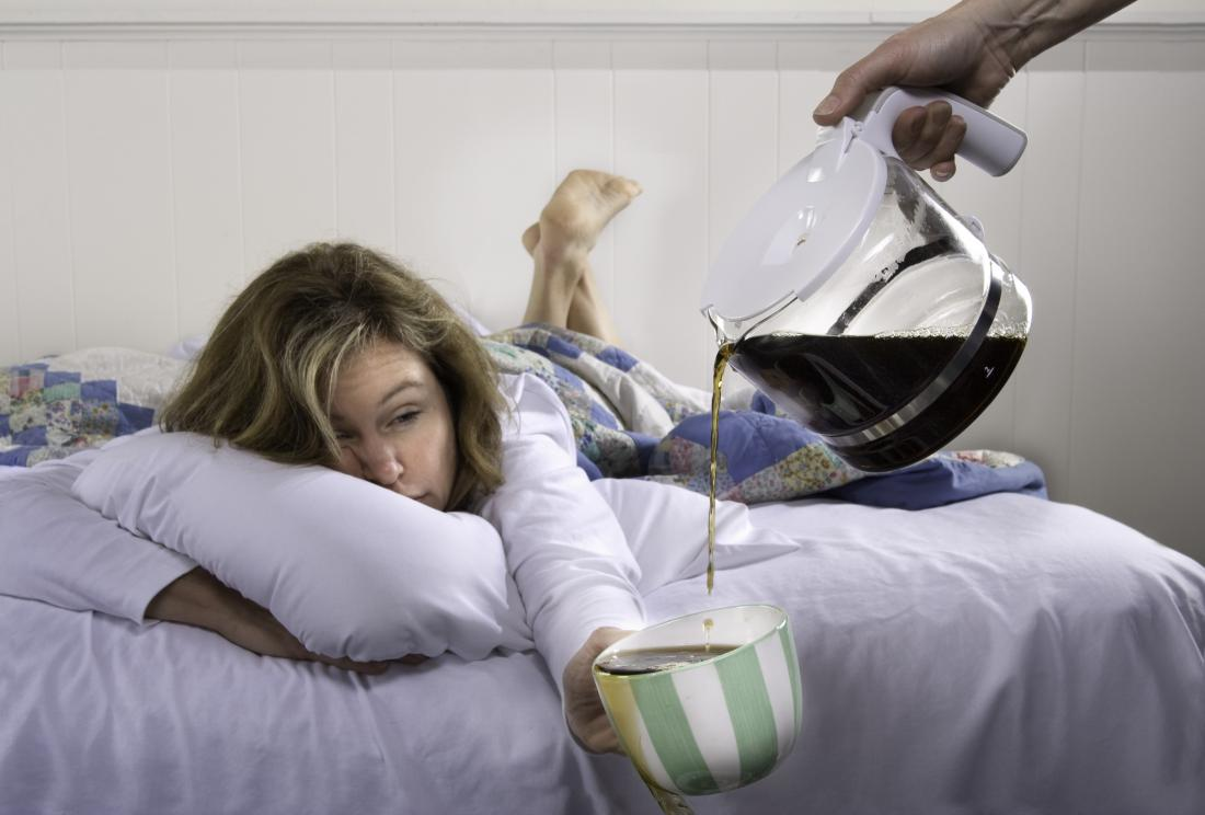 woman in bed drinking coffee which may help to sober up