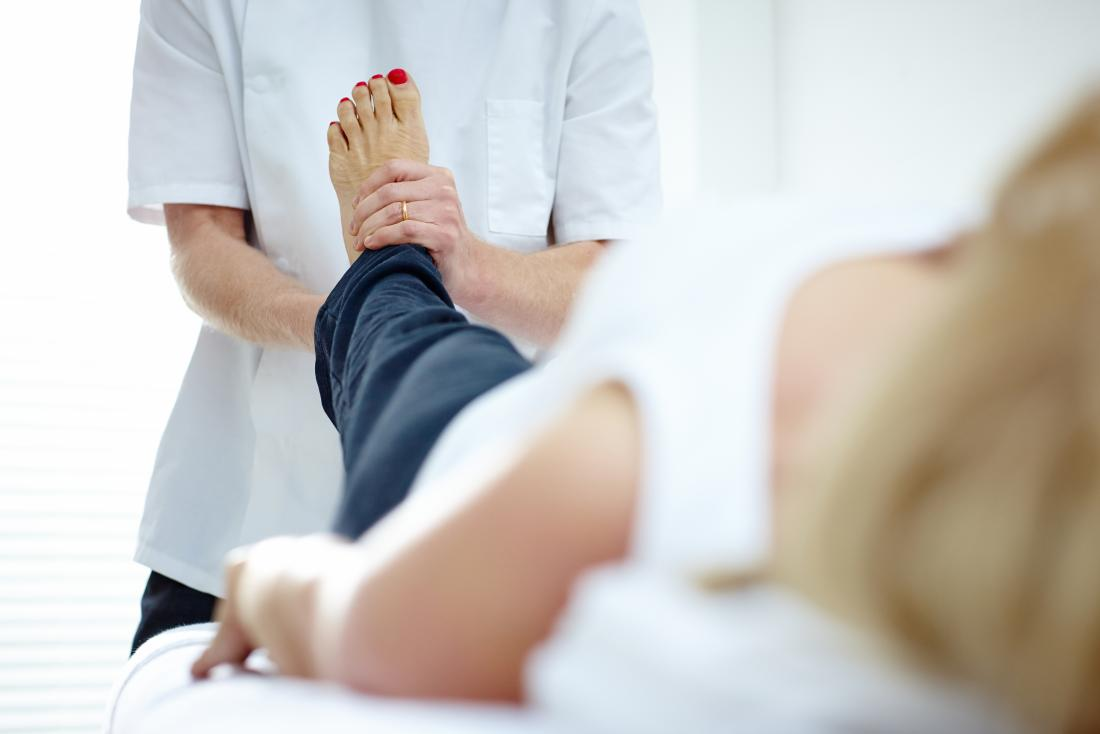 Woman having physical therapy massage on foot.