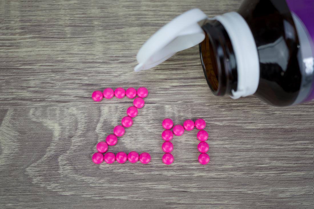 Zinc tablets on a table that may be a natural remedy for enlarged prostate