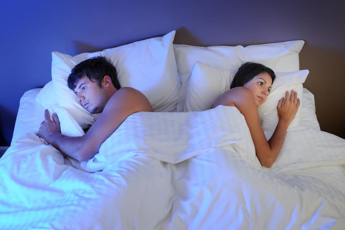 intimate partners not facing each other in bed