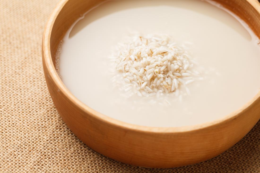 Rice and rice water in a wooden bowl