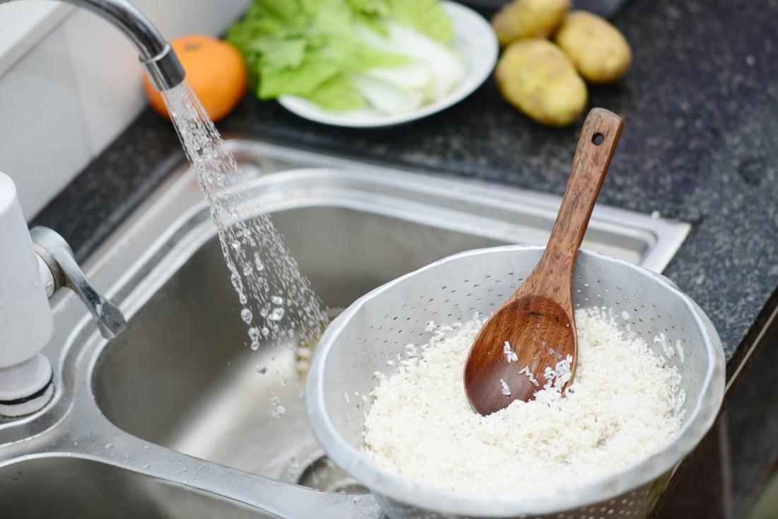Washing rice in the sink