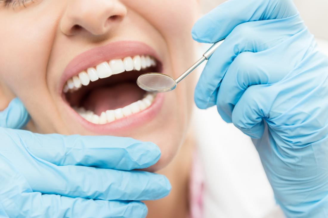 woman at the dentist with possible bad taste in mouth