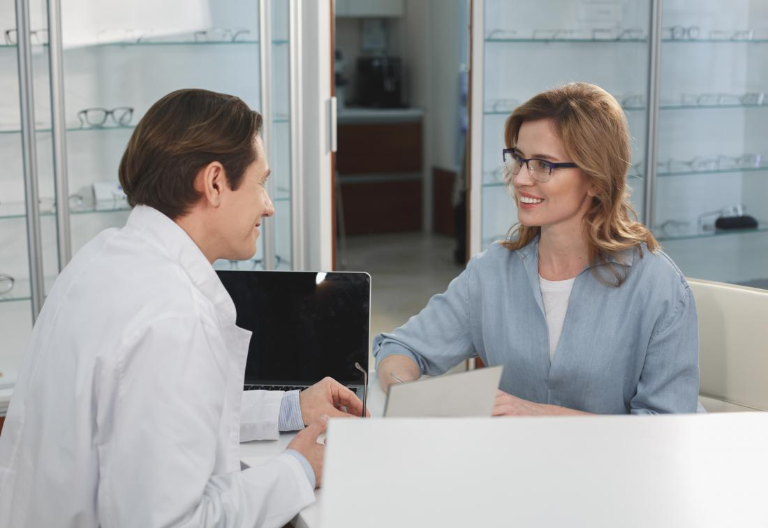 An optometrist discussing with a patient