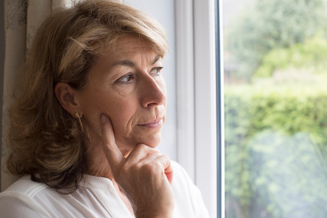 sad woman looking out of window