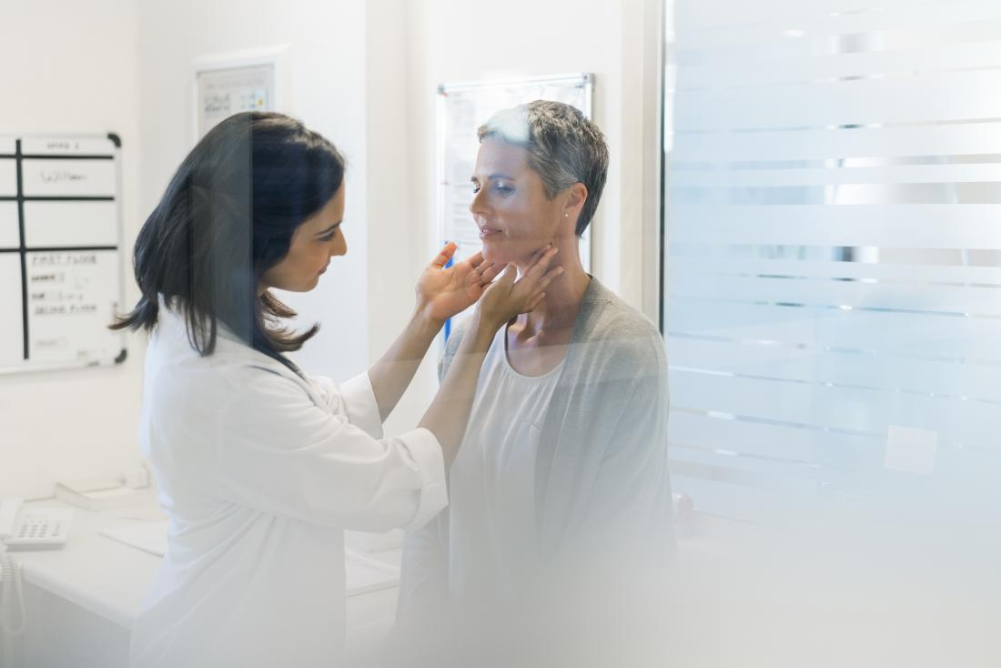 lymph nodes being felt by doctor