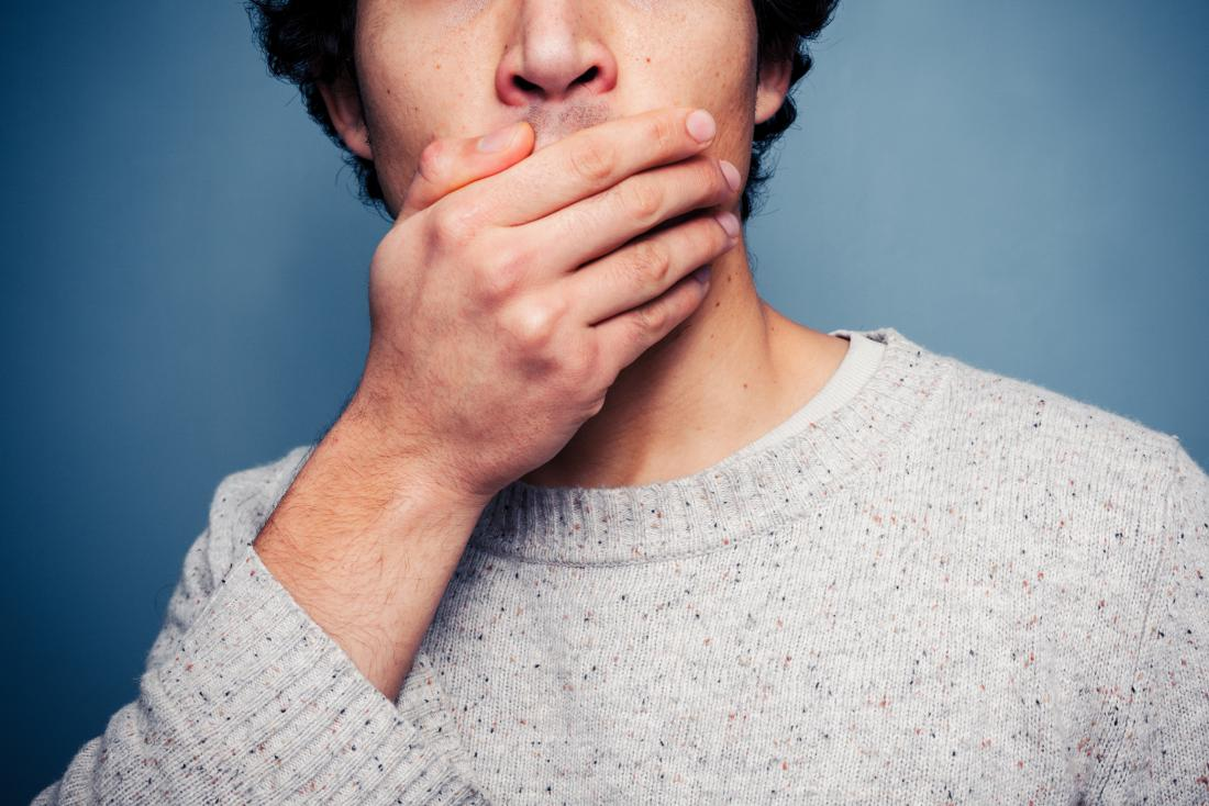 Man covering his mouth with his hand