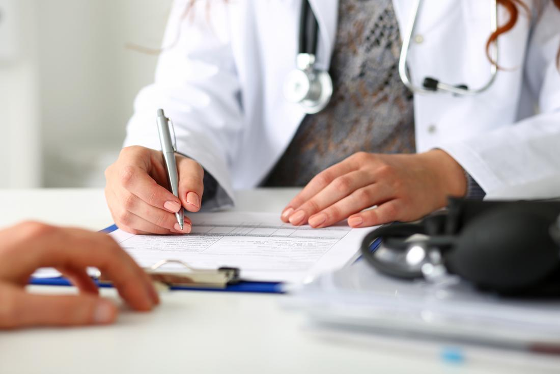 Patient receieving notes from doctor.