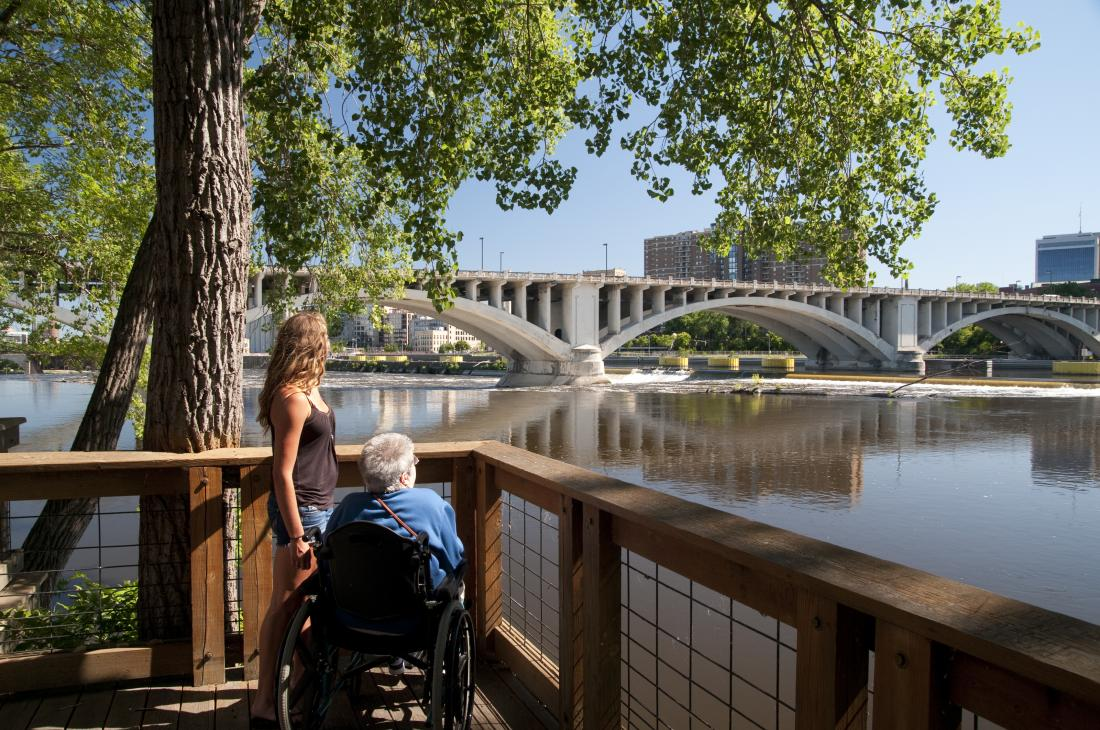 person in a wheelchair and companion enjoy view