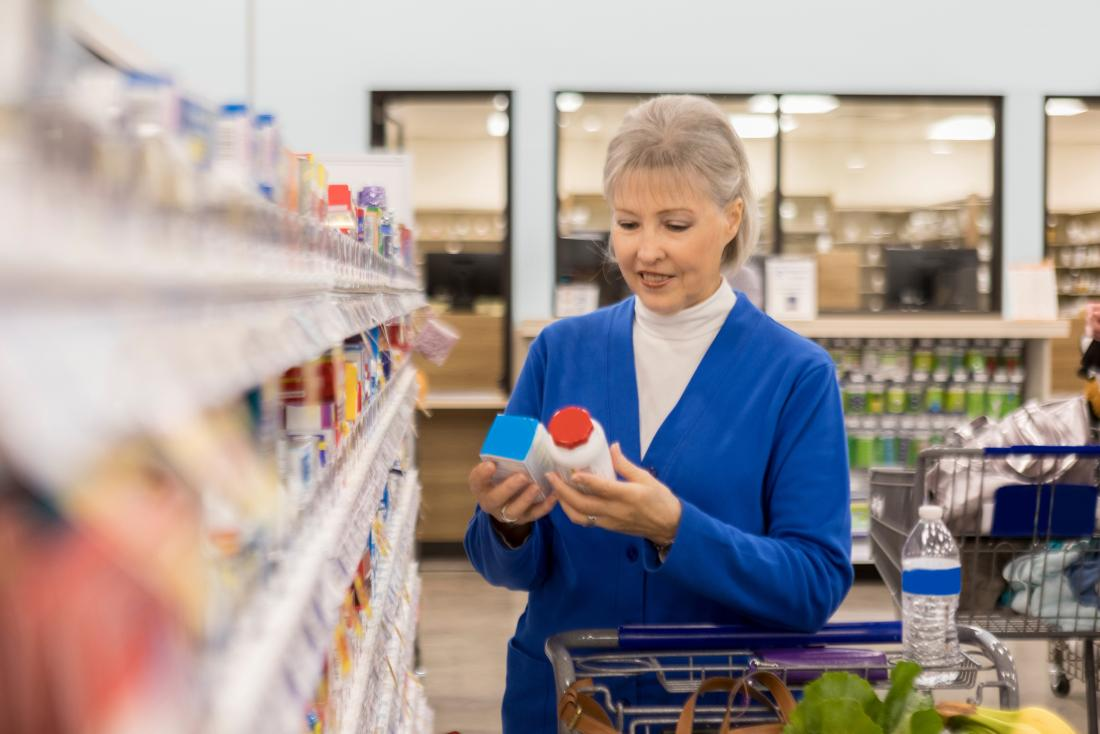 Senior lady looking at natural progesterone products