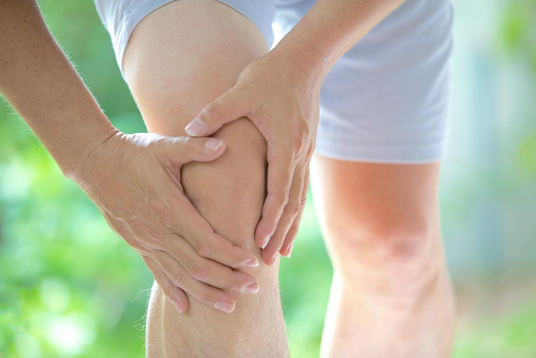 Osteoarthritis pain in knee, flare-up with person holding knee.