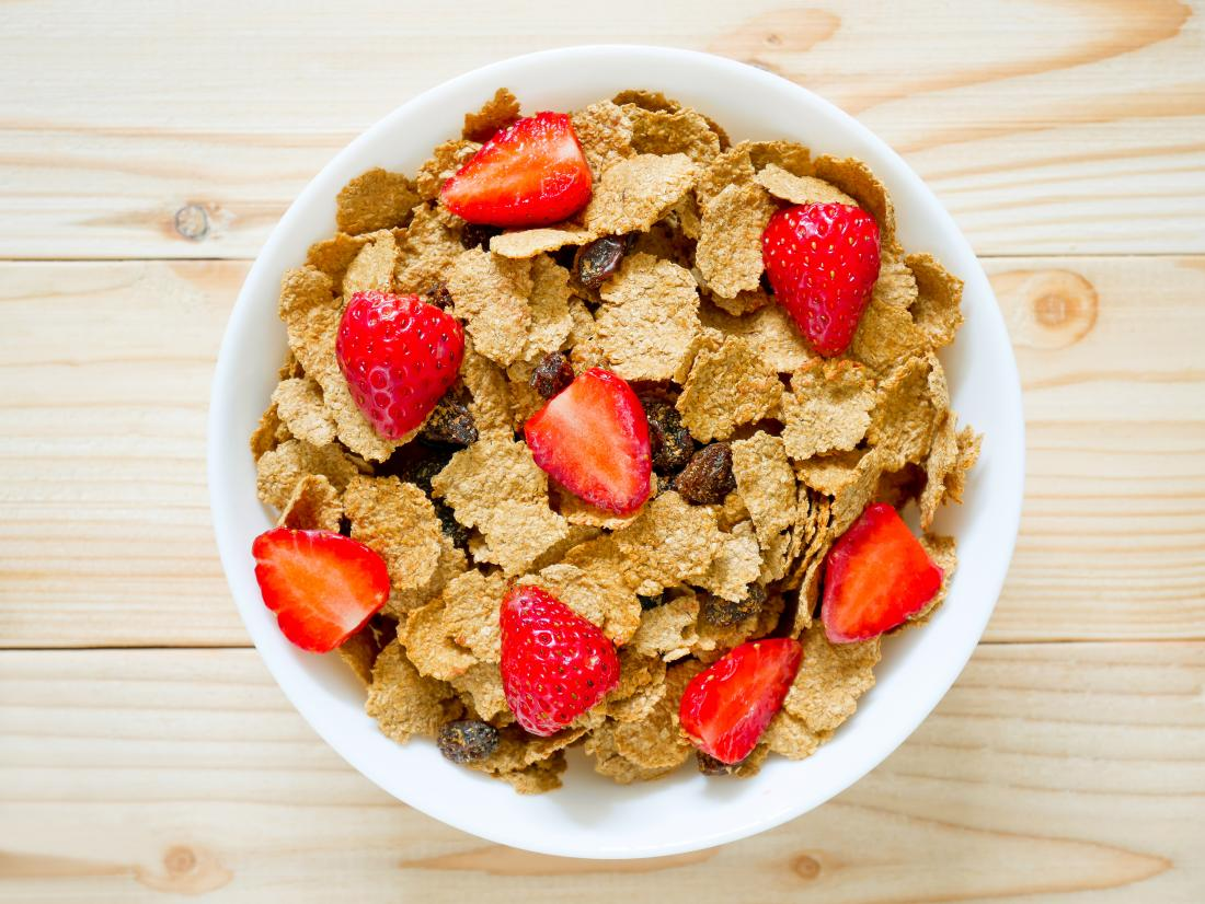 bowl of bran flakes and strawberries
