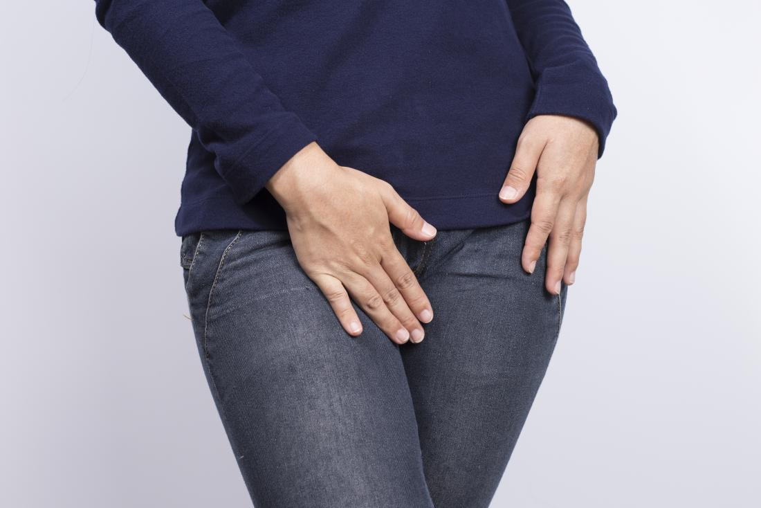 Women with vulvovaginitis health problems covering crotch with hands.