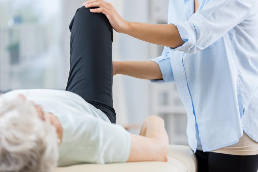 Physical therapy on a senior woman's knee
