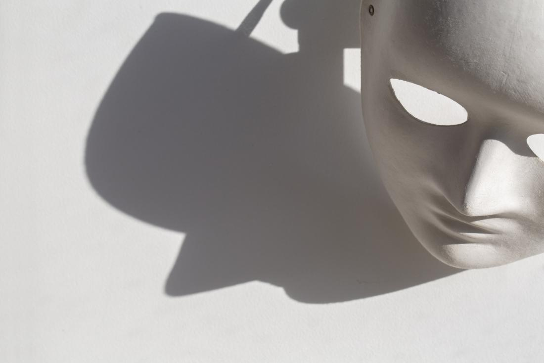 concept photo showing a mask and its shadow