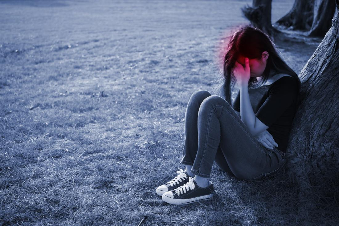 Depressed girl sitting down