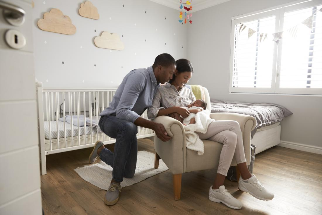 Parents with a newborn baby in a nursery