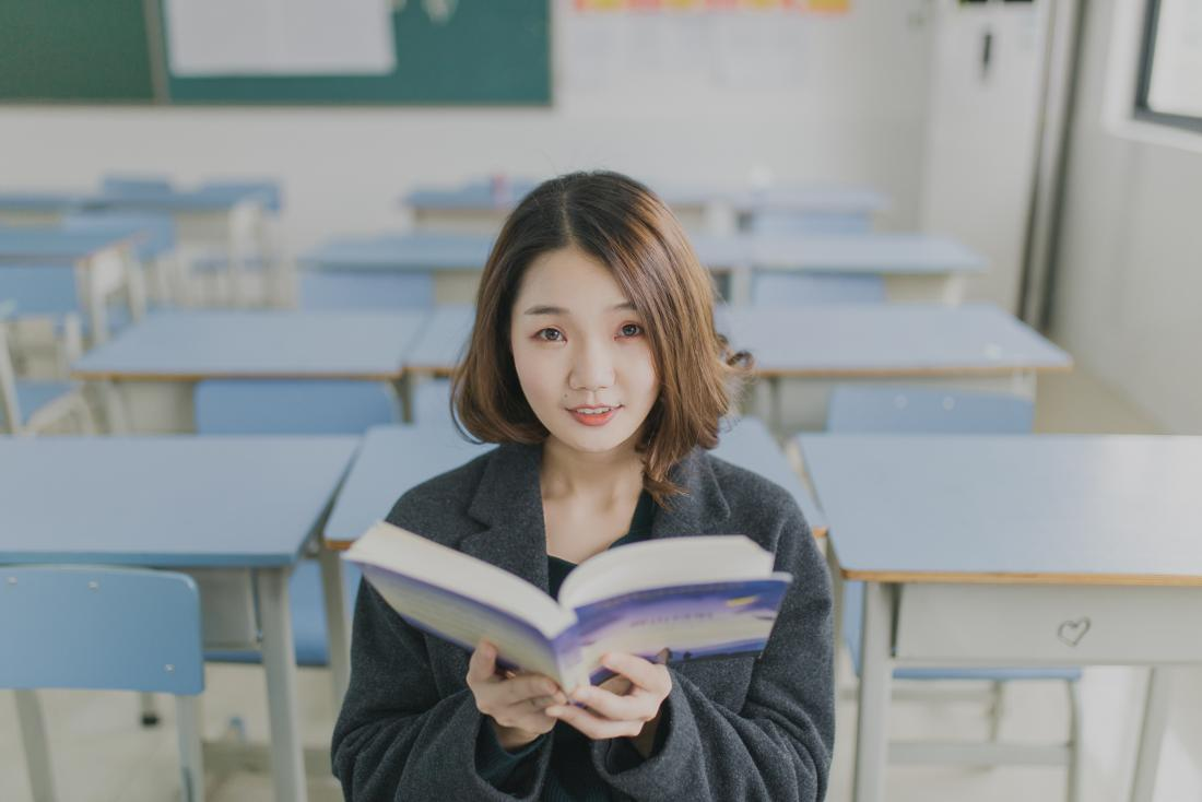 young woman with open book