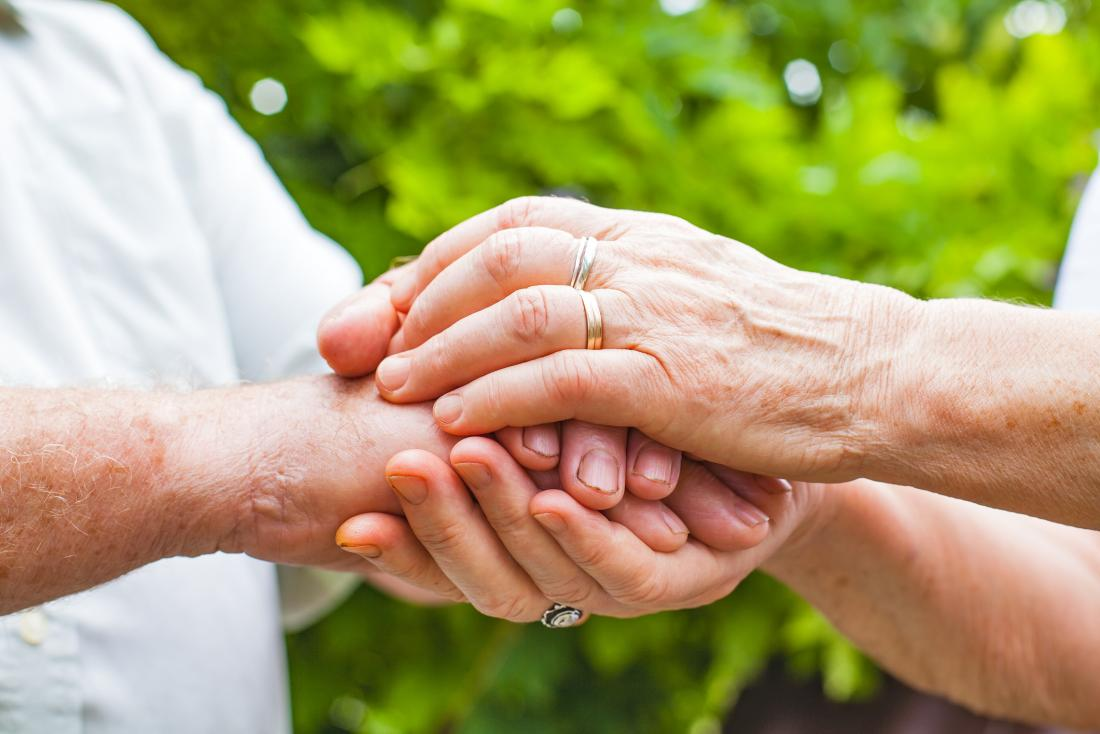 Older adults holding hands