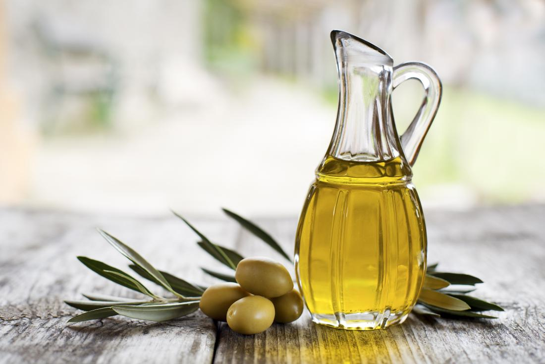 olive oil in a bottle which may be used on the face