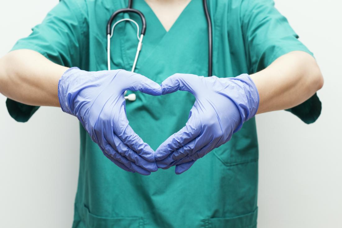 surgeon making heart shape with hands