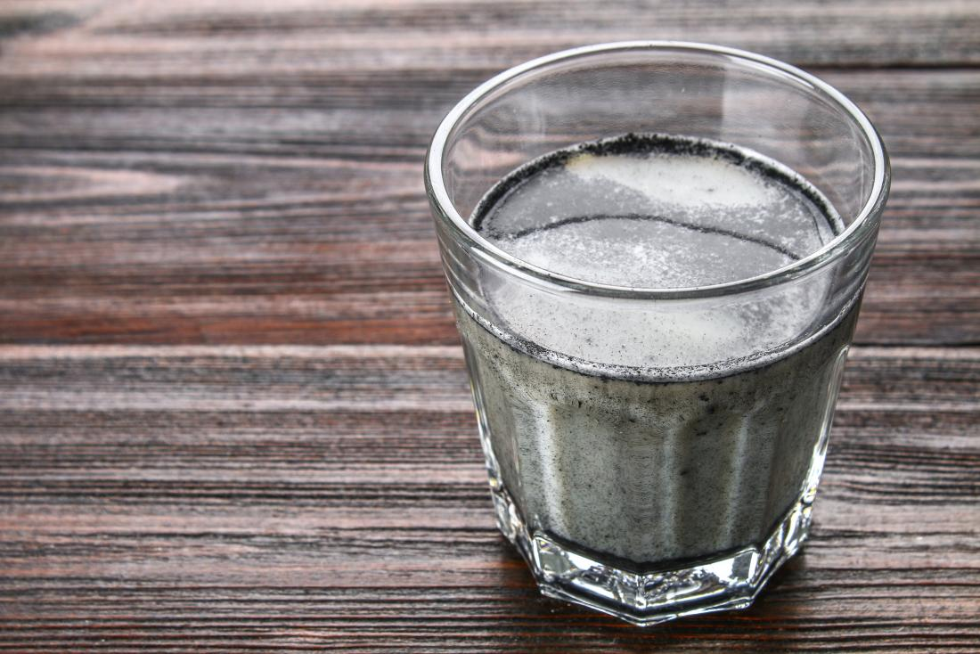 Activated charcoal latte drink in glass