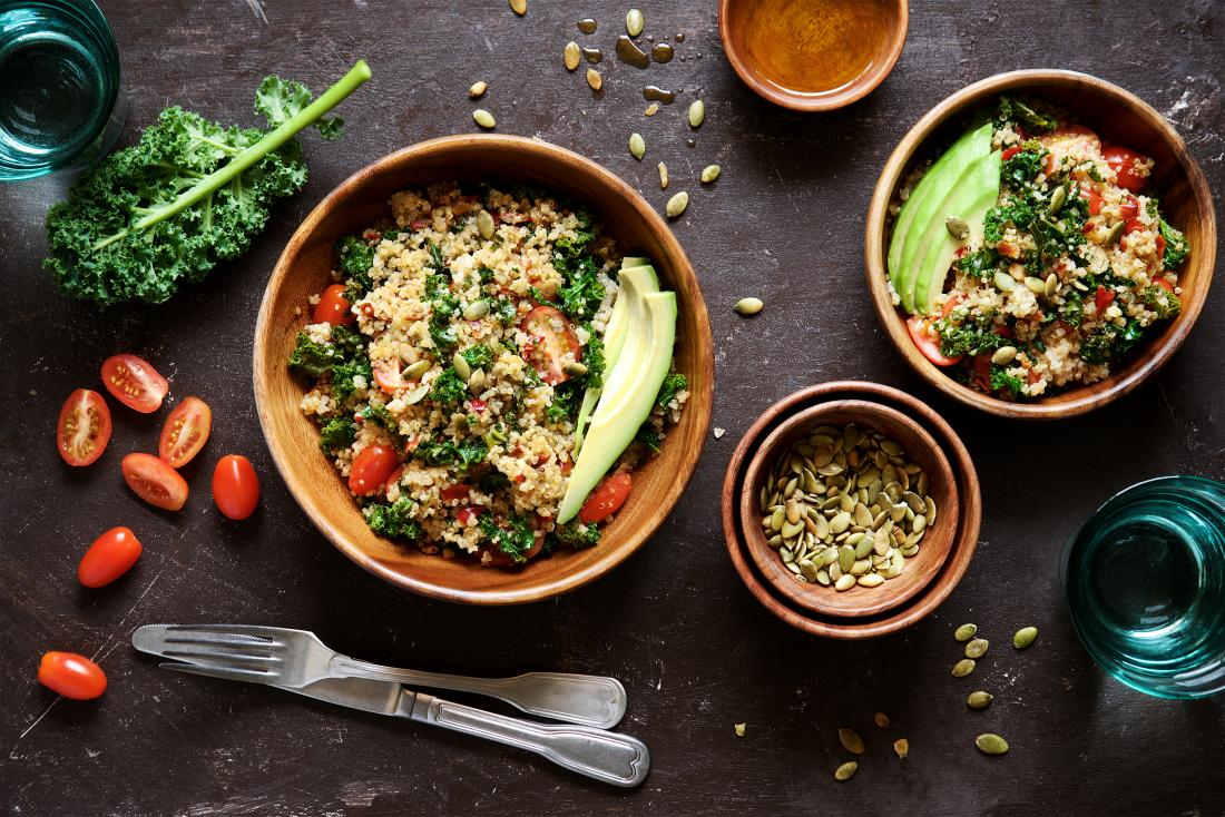 Quinoa salad with kale, cherry tomatoes and pumpkin seeds. Healthy nutritious vegetarian and vegan meal.